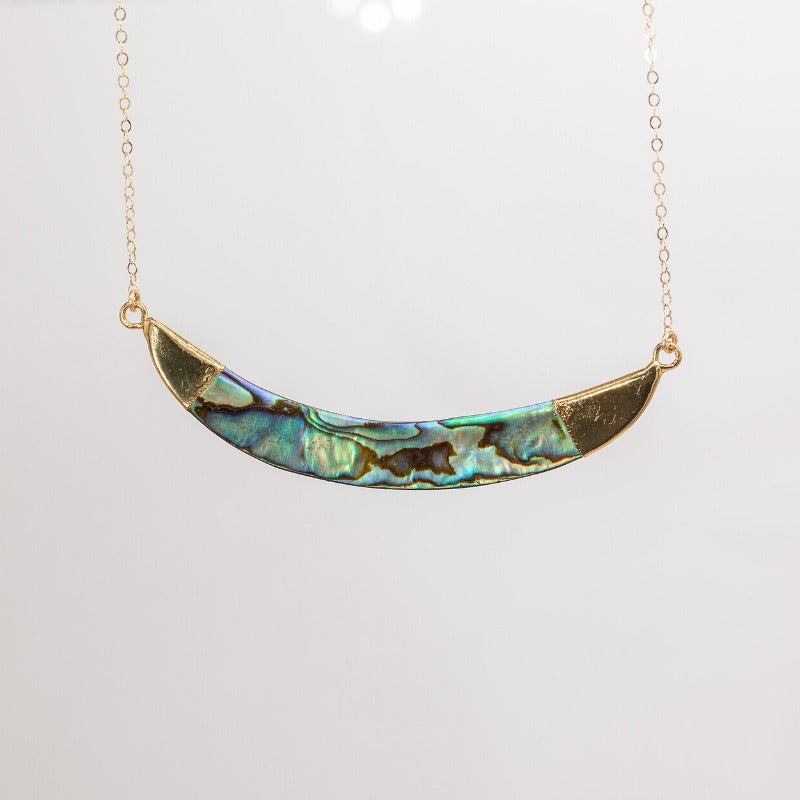 Abalone crescent pendant on gold chain