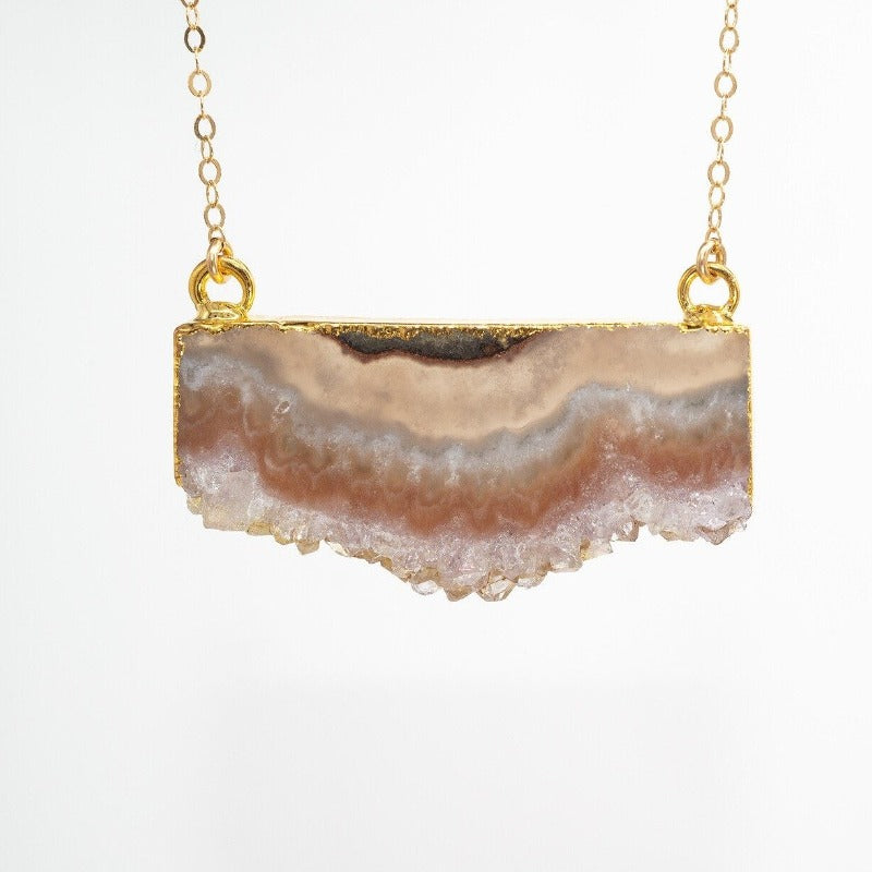 Raw edge amethyst slice pendant with gold chain