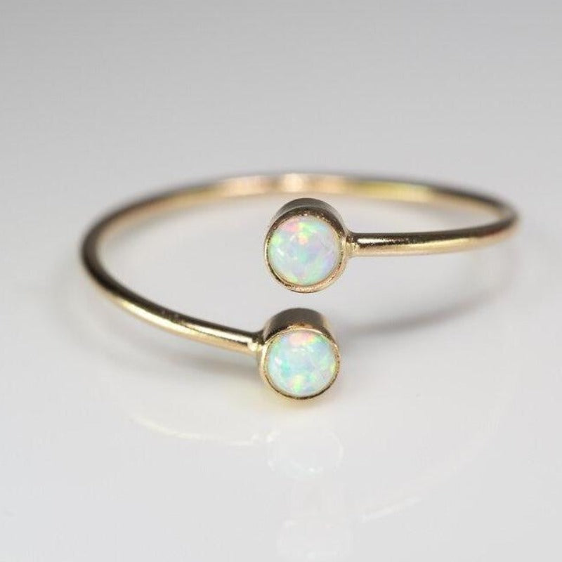 Double set opal ellipsis ring in gold