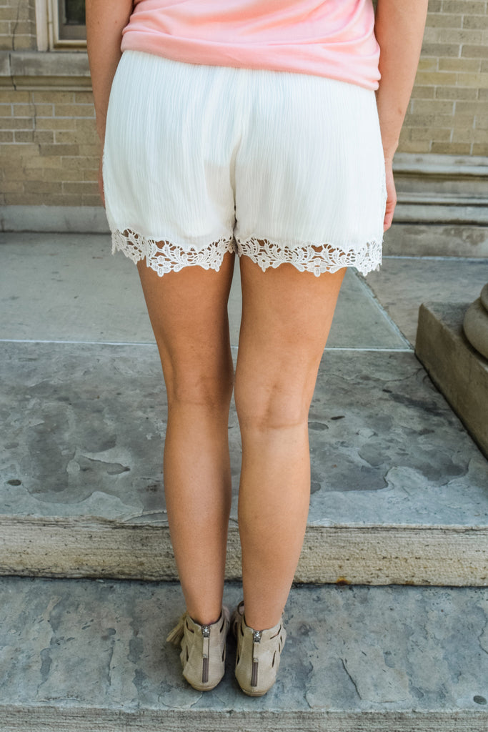 Chic lady in lace shorts ivory