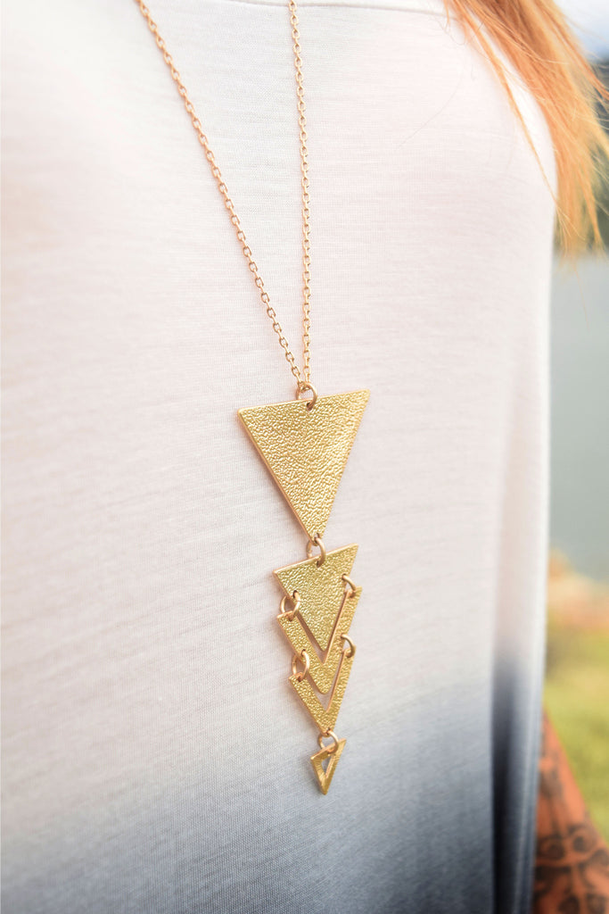 Trendy worn gold triangle pendant
