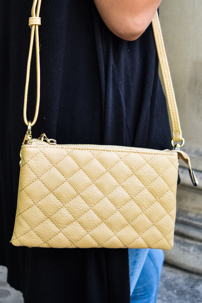Womens Boutique quilted beige clutch