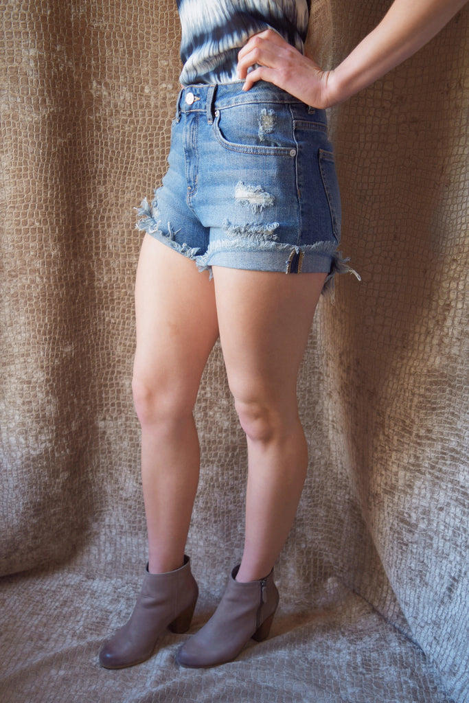 Chic high rise distressed shorts
