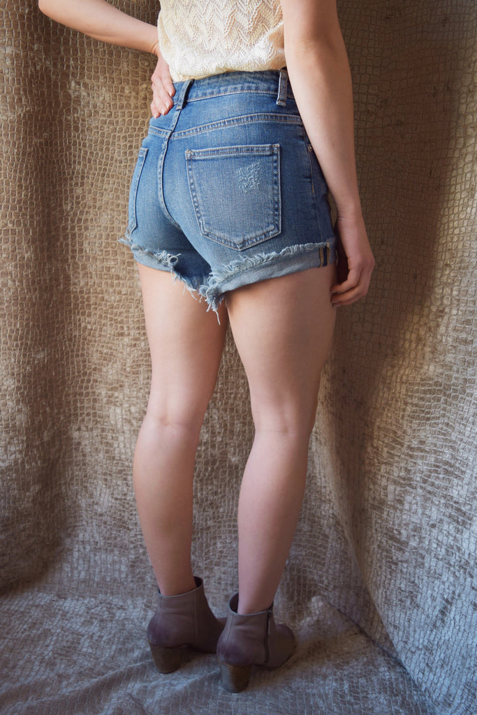 Affordable Online high rise distressed shorts