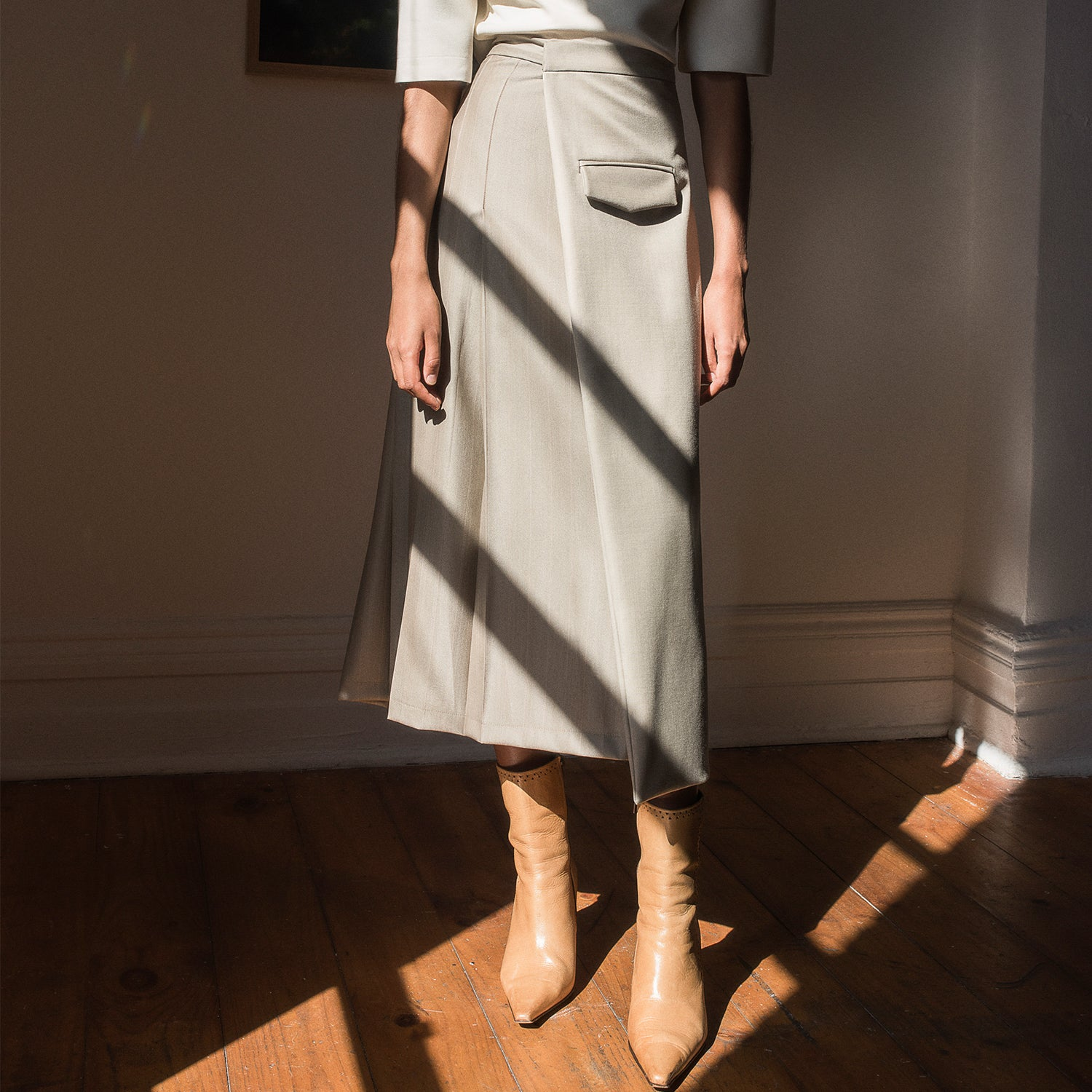 <b>N°4</b> <p><b>stone pleated midi wrap skirt</b> <p>