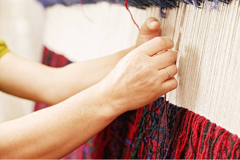 Hand-Knotting a woolen area rug; Why hand-knotted rugs are so expensive.