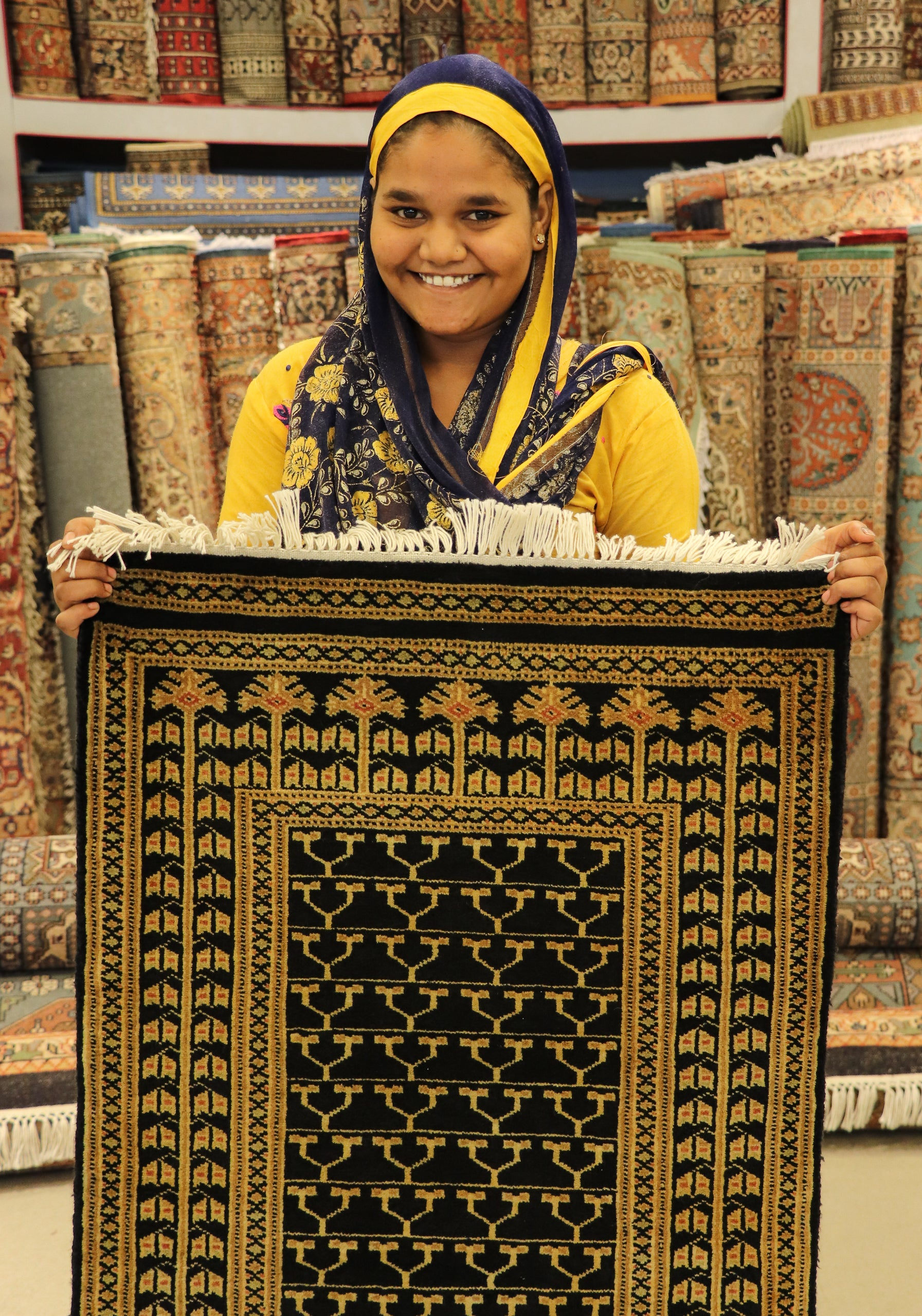 Muskan with a recent carpet made