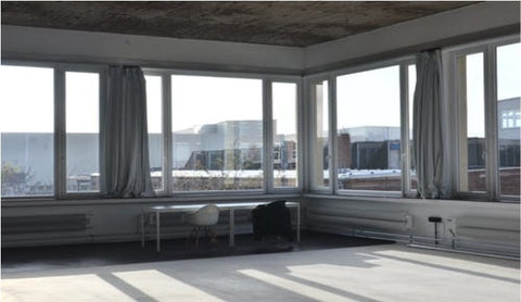 Large windows; sheer curtains; modern interiors