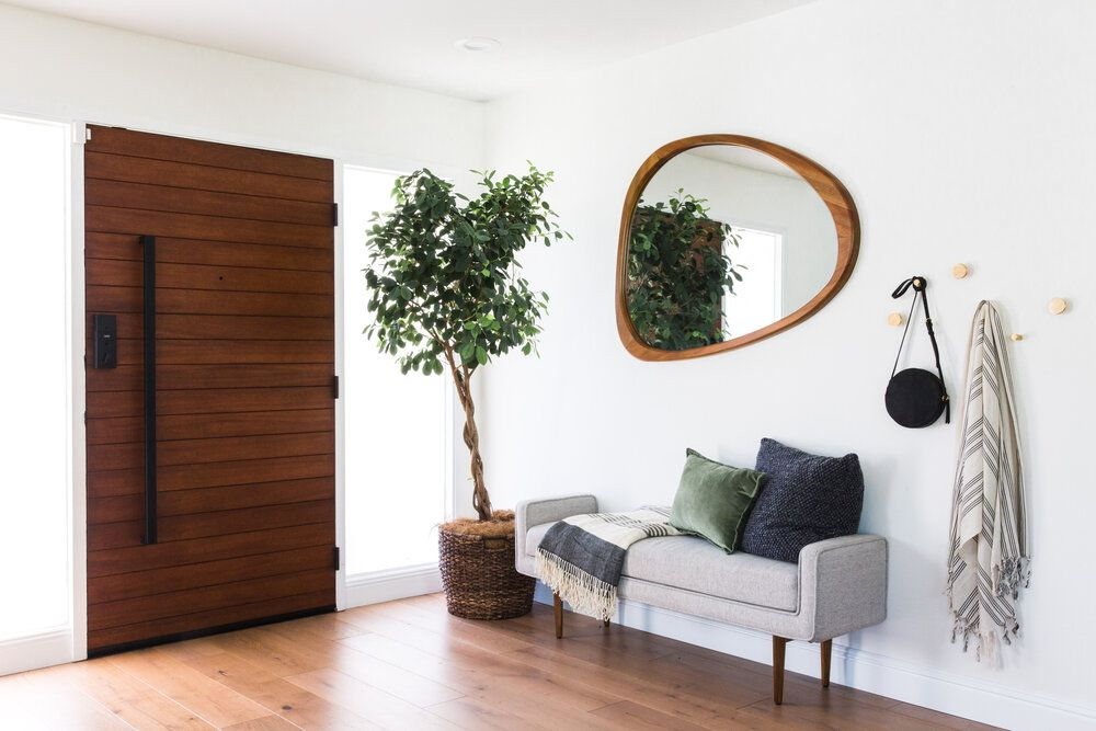 Statement making mirror in a bedroom
