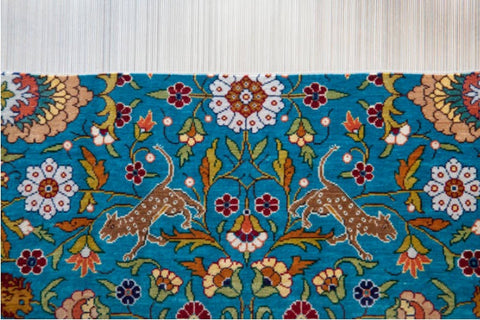 Tribal design hand-knotted rug