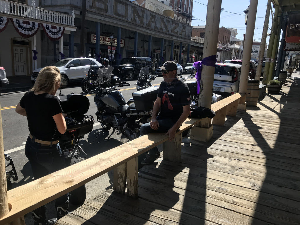 motorcyclists hanging out at Virginia City like cowboys next to their motorcycles California Nevada USA guided tour