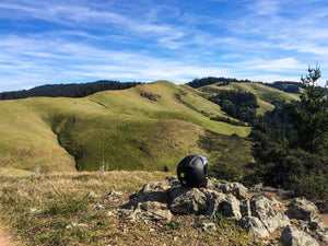 Motorcycle helmet in the California Marin hills during a motorcycle ride with Native Moto Adventures, outside of San Francisco
