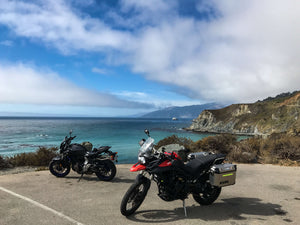 Triumph Tiger 800 and Yamaha MT07 in Big Sur California coast highway 1 or PCH, during a Native motorcycle tour from San Francisco