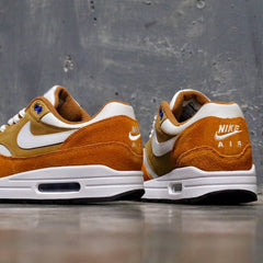 timeless design 4b175 fa54f ... with this retro featuring a Dark Curry, Sport Blue, Black and True  White color combination. This Nike Air Max 1 features a mixture of premium  suede, ...