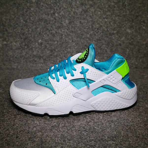 Side view of the Nike Air Huarache White Gamma Blue Electric Green at Solemate Sneakers Sydney