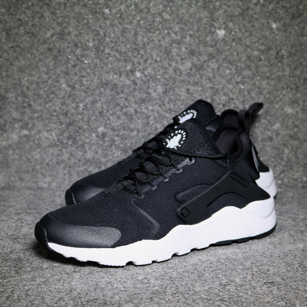 Off Centre View of the Women\u0027s Nike Air Huarache Ultra Logo Black White at  Solemate Sneakers