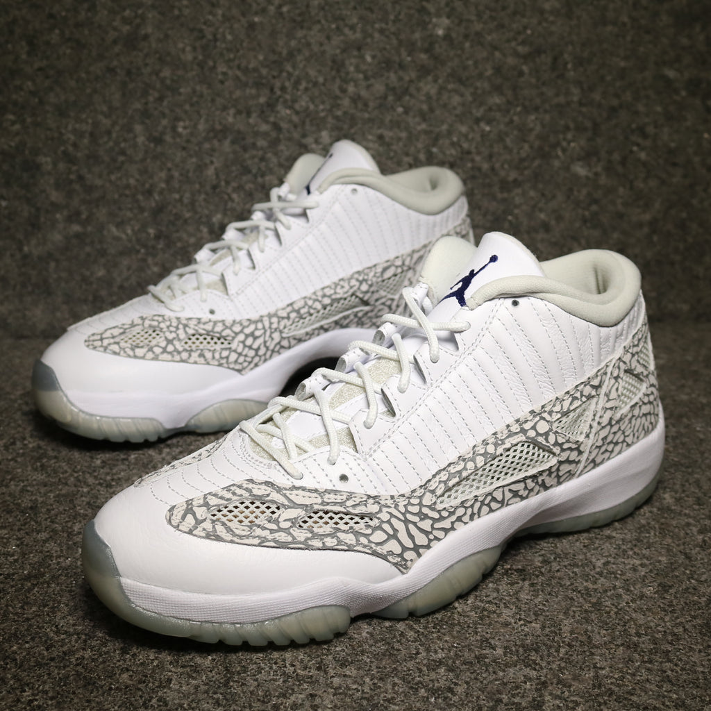 Off Centre View of the Air Jordan 11 IE Low Cobra White Cobalt Zen Elephant Print Cement at Solemate Sneakers Sydney