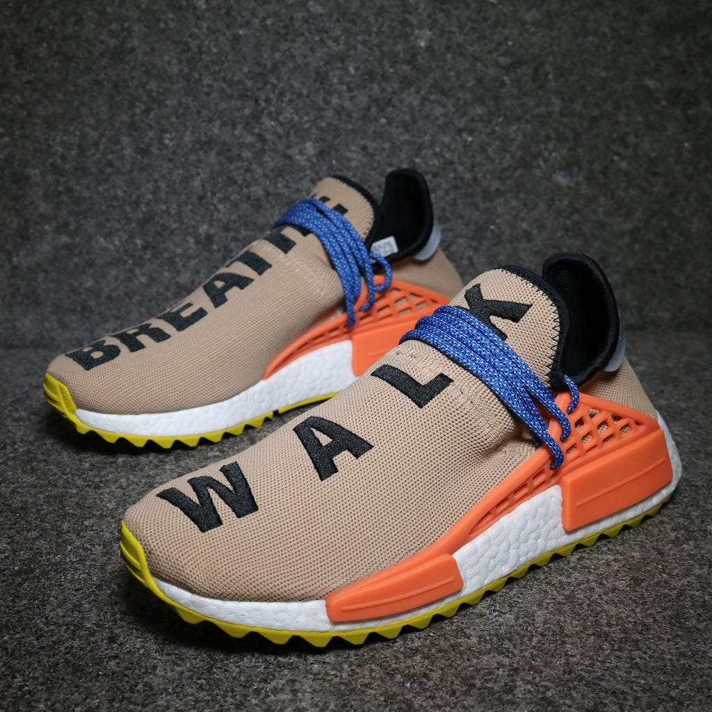Off centre view of the Adidas NMD Human Race Pharrell Pale Nude AC7361 at solemate sneakers