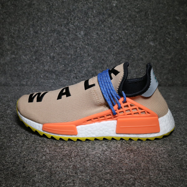 Side view of the Adidas NMD Human Race Pharrell Pale Nude AC7361 at solemate sneaker
