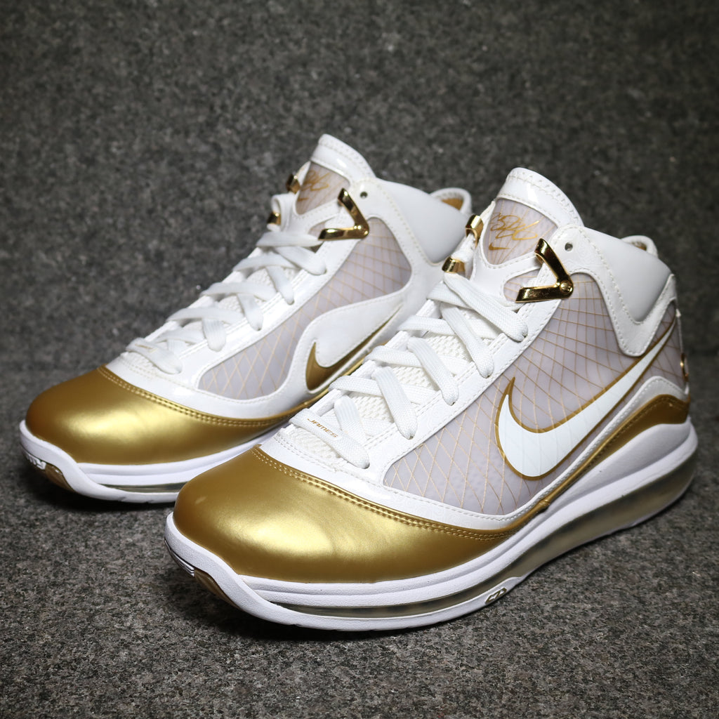 Off Centre View of the Lebron VII 7 Basketball shoe gold and white at Sole Mate Sneakers Sydney