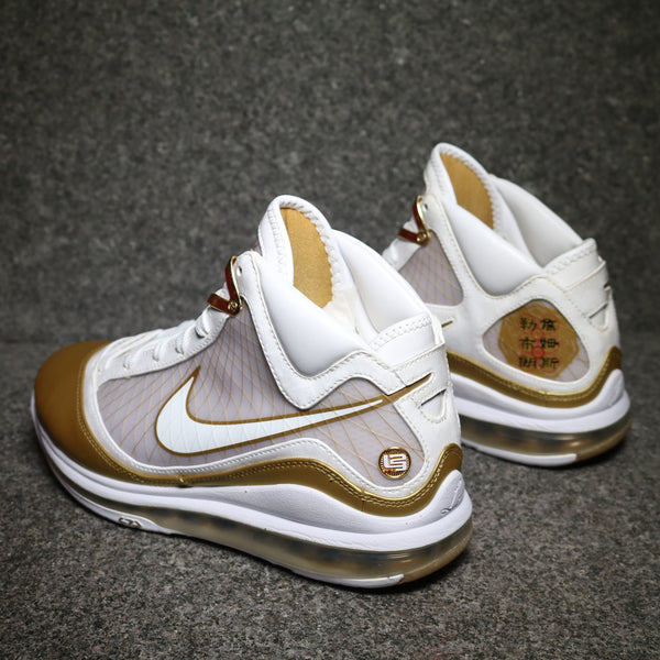Rear view of the Lebron VII 7 Basketball shoe gold and white at Sole Mate Sneakers Sydney