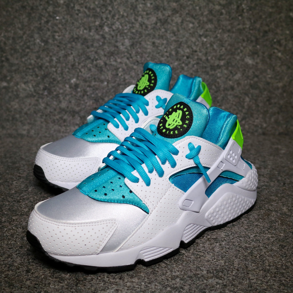 Off Centre view of the Nike Air Huarache White Gamma Blue Electric Green at Solemate Sneakers Sydney