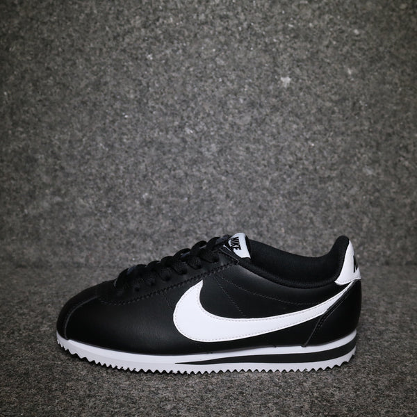 Side view of the Nike Women's Cortez Leather Classic Black White at Solemate Sneakers Sydney