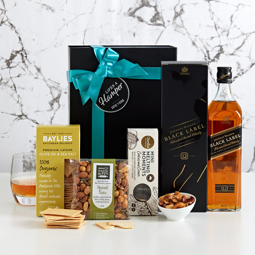 Scotch Lover hamper includes a Johnnie Walker Black label with a selection of gourmet treats.
