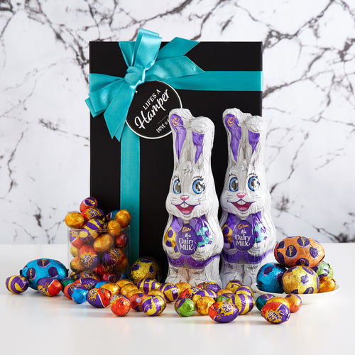 Cadbury Share Easter Hamper includes two cadbury milk chocolate bunnies, hollow eggs and a mixed assortment of small easter eggs. The perfect gift for an easter team celebration.