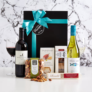 Celebrate with wine gift hamper is a great corporate gift hamper. It comes with a bottle of red and white wine, a delicious assortment of fudge, spiced nuts, nougat and a some crackers. It's a great gourmet food and wine hamper and can be delivered Australia wide.