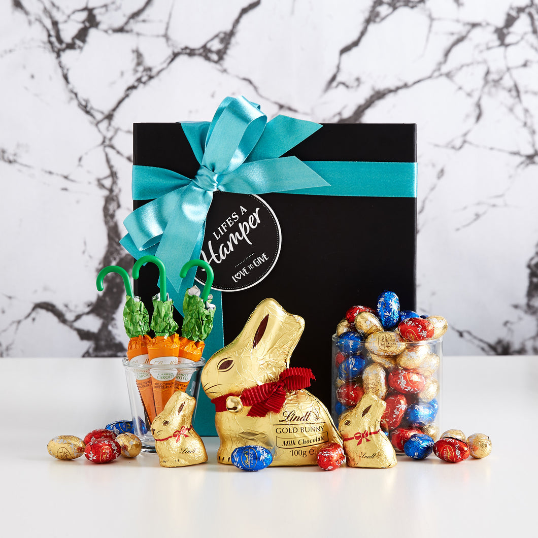 Lindt easter chocolate box hamper filled with a lindt gold bunny, lindt chocolate carrots and lots of mini easter eggs