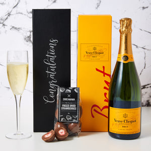 Congratulations Veuve Champagne Hamper comes personalised with Congratulations printed on the box. This hamper also includes a bottle of Veuve Cliquot and chocolate coasted freeze dried strawberries. Our Congratulations Veuve Champagne Hamper is the perfect way to say Congratulations to a colleague, staff or associate. It is also a wonderful settlement gift for new home buyers.