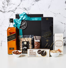 Our scotch lover hamper speaks for itself. It makes a big statement for any celebration.It is stylishly packed with premium products. Perfect gift for Fathers Day, Christmas Client Gifts, Thank you Gifts of as a referral gift.