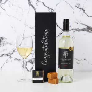 Congratulations Sidewood White Wine Hamper comes personalised with Congratulations printed on the box with decal lettering. This is a modern way to personalise gift hampers making them look very modern. Our Sidewood white wine hamper comes with a bottle of Sauvignon Blanc and a creamy caramel fudge.