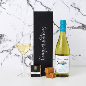 Congratulations Silver Moki White Wine Hamper comes with Congratulations printed on the box with custom decal lettering, a bottle of Silver Moki Sauvignon Blanc and a golden whisk fudge.