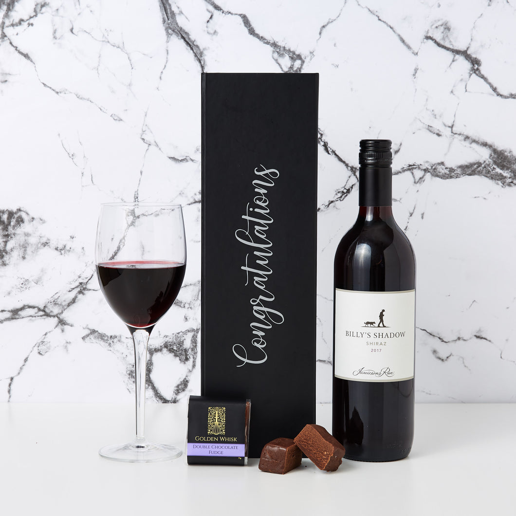 Congratulations with Shiraz Hamper is a simple gift hamper which has the added touch of personalisation. Our Congratulations with Shiraz Hamper comes with a personalised box, a bottle of Billy's Shadow Shiraz and a creamy golden whisk chocolate fudge.