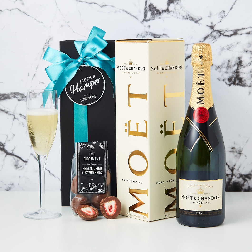 Moet and Chandon Champagne Hamper is the perfect hamper to congratulate a client, friend or family member. The Moet and Chandon hamper comes with a bottle of Moet and Chandon plus a packet of our delicious chocolate coated freeze dried strawberries.