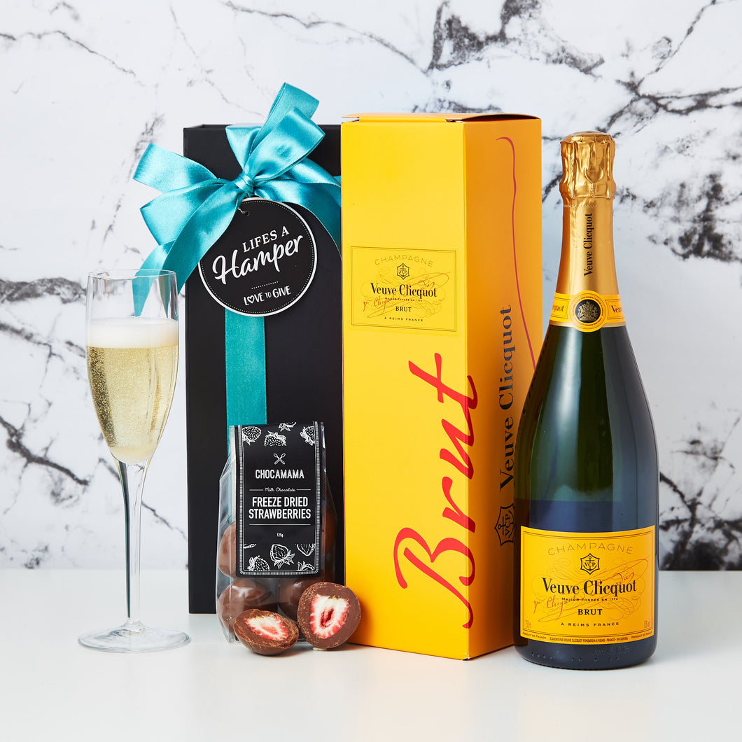 Veuve Champagne Hamper comes in our signature black magnetic box, with a Veuve Cliquot and chocolate covered freeze dried strawberries. This hamper is the perfect way to say Congratulations.