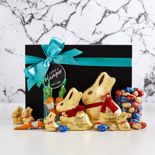 Lindt Easter Egg collection. This gift hamper is includes Lindt gold bunnies, chocolate carrots and an assortment of small easter eggs