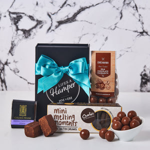 Sweet Petites Hamper is just that. The perfect bite size hamper that has some of our favourite products. Our Sweet petites hamper comes with choc salted mini melting moments, chocolate hazelnut and a creamy chocolate fudge.