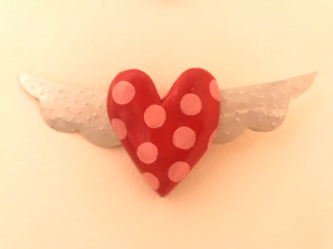 Little red winged dotty heart