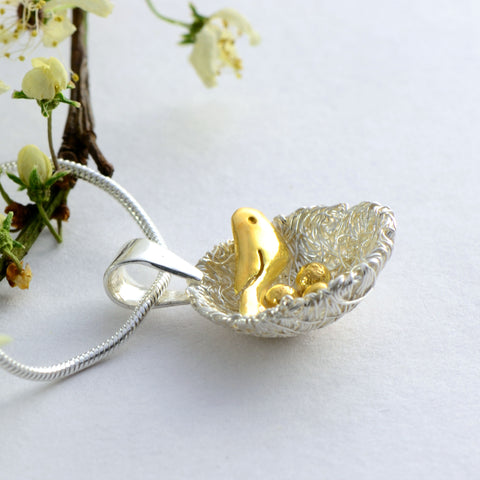 silver and gold nest pendant
