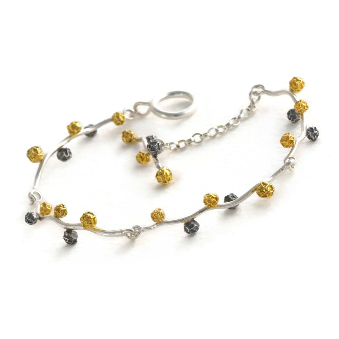 A Floral and fruit bracelet design in sterling silver grains of peppercorn with three colours