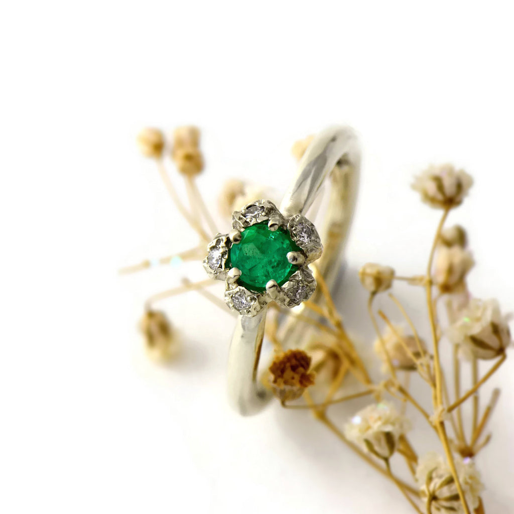 Natural Colombian emerald solitaire engagement ring  with a diamond cluster set in gold peppercorn