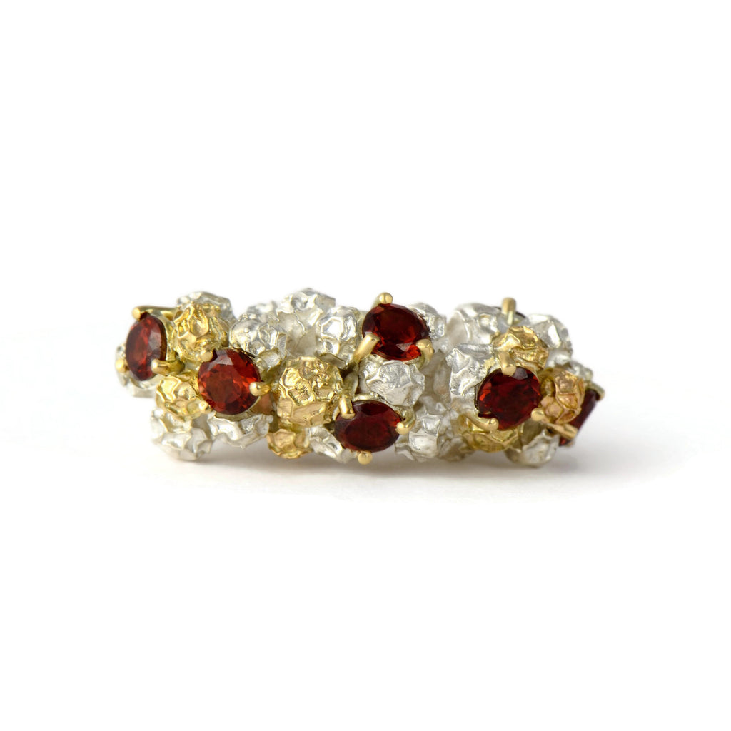 contemporary cock tail ring made in gold, silver and garnets