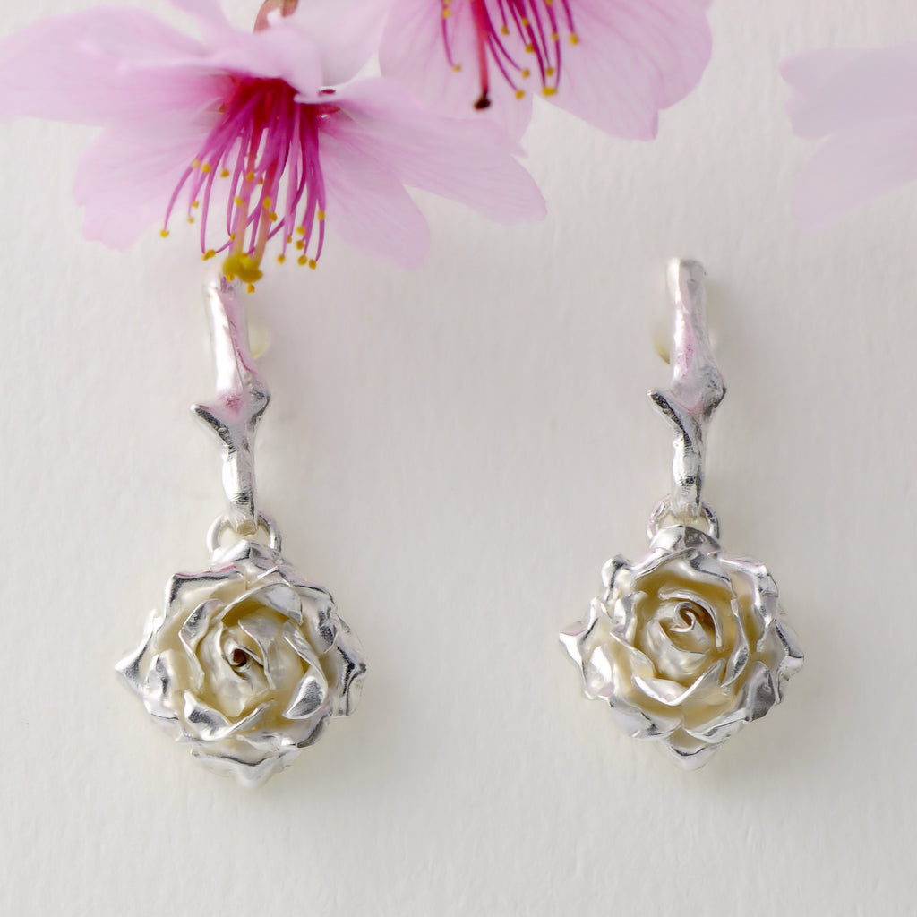 Small dangling rose stud earrings - 1 cm rose suspended by a delicate rose thorn