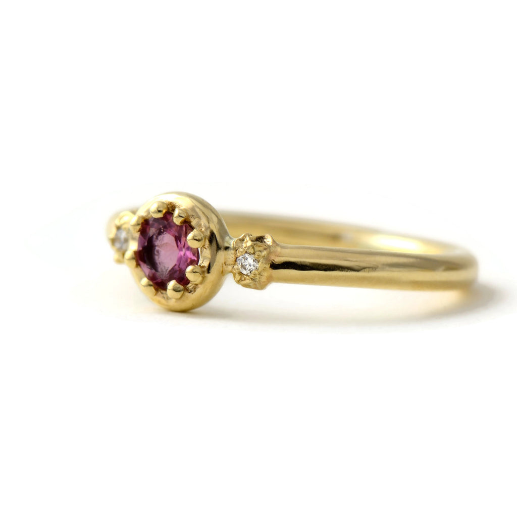 yellow gold and pink gemstone ring