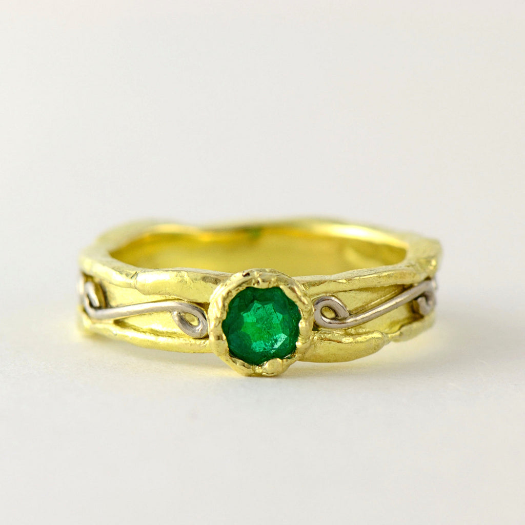emerald solitaire gold ring