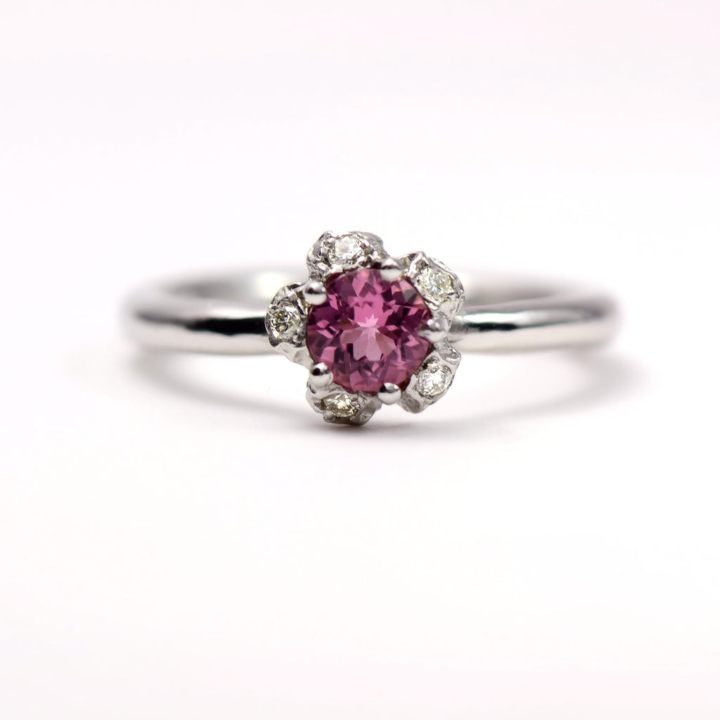 white gold , diamond and pink tourmaline engagement ring