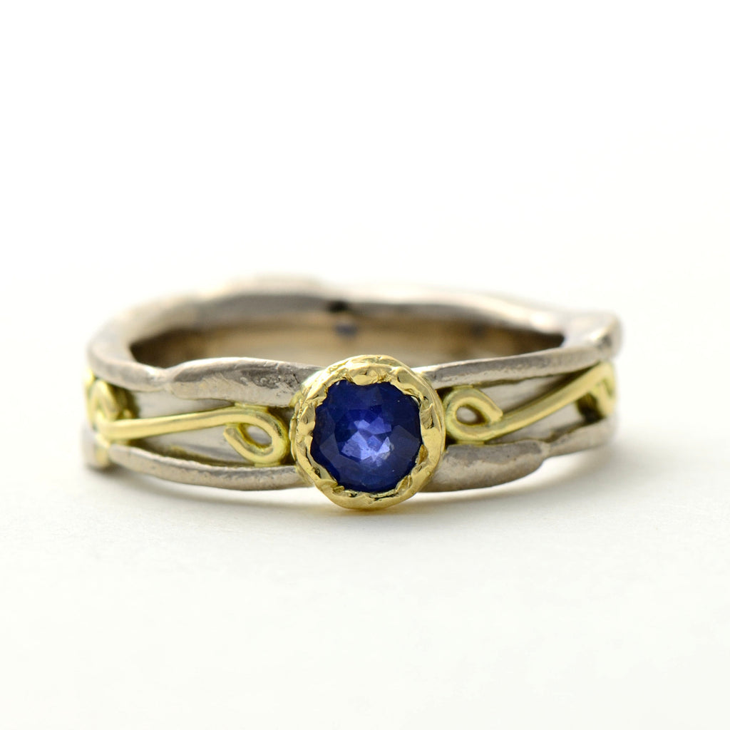white  and yellow gold sapphire ring